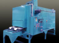 Conveyor oven for sterilizing surgical devices